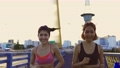 Healthy female friends jogging 76307376