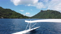 Tahiti Travel in French Polynesia in Outrigger boat in ocean lagoon on Huahine 76309887