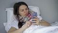 Telemedicine. Sick young woman with flu, cold or coronavirus symptoms calls her doctor. 76323136