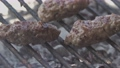 Sausages on the grill slow motion 2 76341435