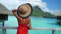 Vacation Travel on Bora Bora. Woman walking on paradise motu beach on holidays on French Polynesia with Mount Otemanu. Happy girl on luxury travel in overwater bungalow resort hotel in Tahiti. 76346264