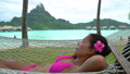 Travel beach vacation Luxury resort holiday woman relaxing lying down in hammock by the overwater bungalows of hotel in Bora Bora, Tahiti, French Polynesia. Happy summer vacation getaway. 76346274