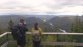 Camping nature woman sitting at picnic table enjoying view of wilderness Quebec 76351754