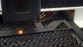 Industrial laser cutting of sheet metal with sparks 76353249