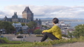 Canada travel Quebec city tourist enjoying view of Chateau Frontenac castle 76353486