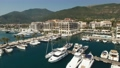 View of the Porto Montenegro marina in Tivat, yachts and boats at the pier, hotel complex 76356013