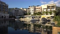 Luxurious hotel complex in the harbor of Porto Montenegro, boats and yachts in the marina at the hotel  76356016