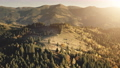 Sun rays at mountain pine forest aerial. Fog over mount ridges. Autumn nobody nature landscape 76365900