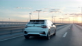 electric car driving along a bridge 76371521