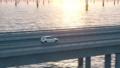 electric car driving along a bridge 76371523