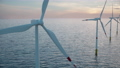 large offshore wind farm or wind park in the sea 76371524