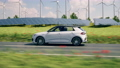electric car driving through the green countryside 76371534
