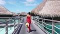 Vacation Travel woman walking on pontoon of overwater bungalow resort hotel 76376593