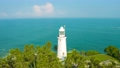 Panoramic view of a old white lighthouse standing at the coast of tropical island near Sri-Lanka 76379134