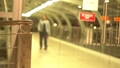One Person Walking in Airport Terminal.Woman out of Focus Blurred Defocused Background Shot in Slow Motion. 76388524