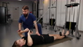 Rehabilitation concept. Young man doing exercises under physiotherapist 76390278