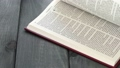 Close up of leafing book pages on gray wooden table 76402652