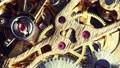 Watch mechanism macro .Old vintage clock mechanism working. 76404031