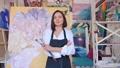 Portrait of talented female artist wearing apron 76408153