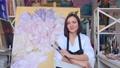 Portrait of talented female artist wearing apron 76408175