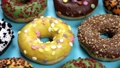 assorted donuts with icing 76416794