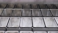 molds on the conveyor for baking bread at the bakery 76416805