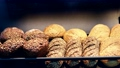 many different types of bread. Wholegrain, round, rolls and loaves 76416807