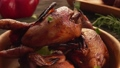 Close-up view of chopped green onion falling on the delicious fried quails 76419268