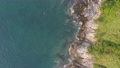 Amazing aerial view Top down drone shot of beautiful mountain seashore with tropical sea wave crashing on rocks stones in summer season island Concept travel and tour background and travel website 76423376