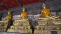 the buddha statues in the Traimit Withayaram Worawihan temple in Bangkok 76468787