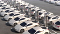 Rows of electric cars standing on recharging. 76494939