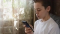 Young boy at home with smartphone 76506254