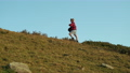 teenage girl is hiking alone at top of hill, backpacking at summer vacation 76526089