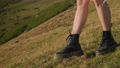 woman is walking on slope of hill at summer day, closeup of feet 76526090