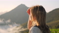 Girl backpacker staring at mountain scene 76526092