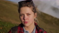portrait of blonde blue-eyed young woman at nature at top of mount, closeup of face 76526101