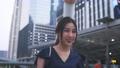 Young businesswoman walking using phone 76528810