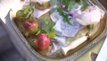 Wedding rings, young pomegranates with names written on them, wax seal, rosebuds and green twigs on a shiny silver tray 76532541