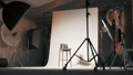 Empty photo studio with chair. Professional photo studio with lights on. 3d visualization 76542405