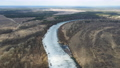 Drone view on spring thaw and Desna river in Ukraine. Bird's eye view of the river in ice in early spring. 76548491