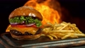Super Slow Motion Shot of Hamburger, French Fries and Flames at 1000fps. Filmed with High Speed Cinema Camera at 4K. 76551301