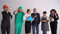Six people in uniforms of different professions. Labor day concept. Various professions and occupations, builder, doctor, secretary, lawyer, cook, consultant 76560098