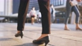 Legs of young businesswoman walking 76605458