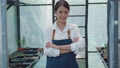 young gardener woman confident with apron standing posing crossed arms 76605584
