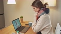 Woman in self-isolation communicates with a doctor by video call using a laptop, a patient consults a doctor online while in quarantine, coronovirus pandemic. 76609416