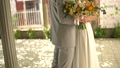 The bride and groom hug on the shady street of the old city, the bride holds a bouquet  76646441