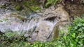 Creek water running on stone stairway 76650297
