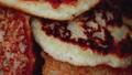 Delicious traditional potato pancake with golden crust, macro. Homemade 76675858