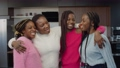 Portrait of affectionate pretty african mom and cute cheerful teenage daughters with braided hair standing in love embrace, showing carefree mood, happiness and strong bond while family posing indoors 76684116