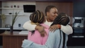 Portrait of affectionate caring beautiful black mother embracing tight and kissing two adorable teenage daughter with braided hair, showing strong bond, love and happiness in home interior. 76684119
